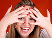 Woman with fingers over her face Royalty Free Stock Photos