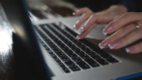 Woman fingers working on a computer keyboard at night. Technology in everyday life. Fingers taping keyboard screen night late work computer close up corporate stock video