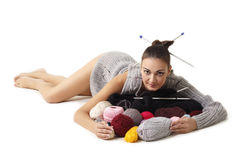 Woman finish knitting sweater. Isolated on white background Stock Photos