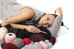 Woman finish knitting sweater Royalty Free Stock Photography