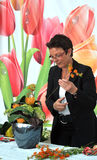 Woman finishing beautiful and rich bouquet Stock Photo