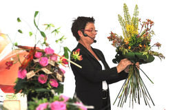 Woman finishing beautiful and rich bouquet Stock Photography