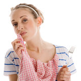 Woman finishing her lunch and wiping her mouth with napkin Stock Image