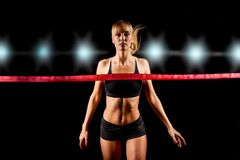 Woman finishing through red tape Royalty Free Stock Images