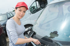 Woman finishing to polish car with wax. Woman finishing to polish a car with wax Stock Photo
