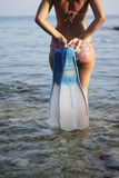 Woman with fins Stock Photography