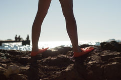 Woman with fins standing by the sea Stock Photography