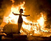 Woman on fire. Cartoon figure showing the concept of a woman handling a crisis Stock Photography