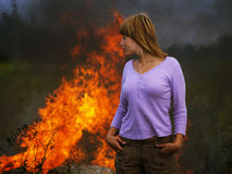 Woman in fire Stock Image