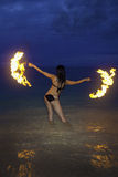 Woman with fire on the beach at night Stock Photos