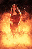 Woman on Fire. Beautiful woman standing in the midst of a fire Royalty Free Stock Images