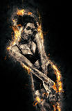 Woman into the fire Royalty Free Stock Image