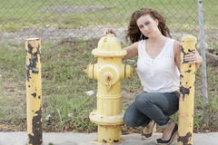 Woman by a fire hydrant Royalty Free Stock Image