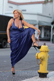 Woman by the fire hydrant Royalty Free Stock Photos