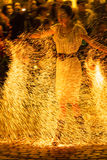 Woman in fire show Royalty Free Stock Images