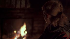 Woman in a fireplace stock video footage