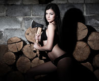 Woman and firewood Stock Images