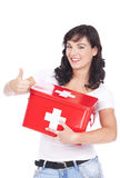 Woman with first aid kit and thumbs up Royalty Free Stock Photo