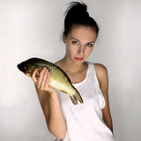 Woman with fish Royalty Free Stock Images