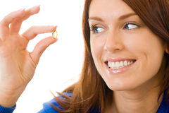 Woman with fish oil capsule Royalty Free Stock Photos