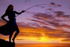 Woman fish pole sunset Stock Photos
