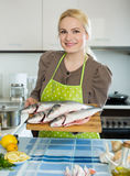 Woman with fish Royalty Free Stock Photography