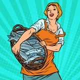 Woman fisherman with a basket of fish. oceanic herring and cod. Traditional craft. Pop art retro vector illustration vintage kitsch royalty free illustration