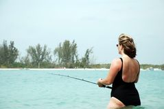 Woman fishing Royalty Free Stock Images