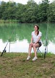 Woman Fishing at a lake Royalty Free Stock Image