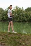 Woman Fishing at a lake Royalty Free Stock Photography