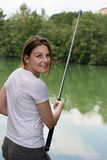 Woman Fishing at a lake Stock Photos