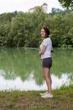 Woman Fishing at a lake Stock Images