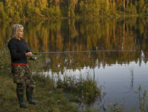 Woman fishing in lake Royalty Free Stock Images