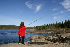 Woman fishing stock photography