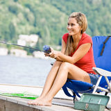 Woman fishing on pier Royalty Free Stock Photography