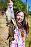 Woman fishing Piranha Stock Images