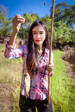 Woman fishing Piranha Stock Photos