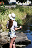 Young woman while fishing  on a river in Bavaria Royalty Free Stock Photo