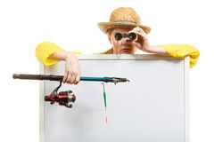 Woman with fishing rod holding board. Fishery, spinning equipment, angling sport and activity concept. Woman with fishing rod and binoculars holding blank white royalty free stock image