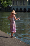 Woman with Fishing rod on IL river at little France quarter in Strasbourg. STRASBOURG - France - 25 May 2017 - woman with Fishing rod on IL river at little royalty free stock images