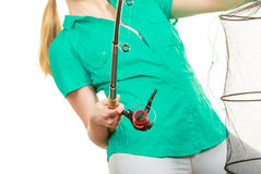 Woman with fishing rod, spinning equipment. Fishery, spinning equipment, angling sport and activity concept. Woman with fishing rod stock photography