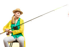 Woman with fishing rod , spinning equipment. Fishery, spinning equipment, angling sport and activity concept. Woman with fishing rod royalty free stock photo