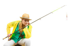 Woman with fishing rod , spinning equipment. Fishery, spinning equipment, angling sport and activity concept. Bored woman with fishing rod, waiting for fish to stock images