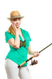 Woman with fishing rod, spinning equipment. Fishery, spinning equipment, angling sport and activity concept. Bored woman with fishing rod, waiting for fish to stock photos