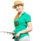 Woman with fishing rod, spinning equipment. Fishery, spinning equipment, angling sport and activity concept. Happy smiling woman with fishing rod royalty free stock photography