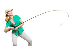 Woman with fishing rod, spinning equipment. Fishery, spinning equipment, angling sport and activity concept. Happy smiling woman with fishing rod royalty free stock photos
