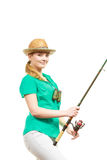 Woman with fishing rod, spinning equipment. Fishery, spinning equipment, angling sport and activity concept. Happy smiling woman with fishing rod royalty free stock image