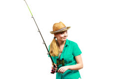 Woman with fishing rod, spinning equipment. Fishery, spinning equipment, angling sport and activity concept. Happy smiling woman with fishing rod royalty free stock photo