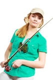 Woman with fishing rod, spinning equipment. Fishery, spinning equipment, angling sport and activity concept. Happy smiling woman with fishing rod stock photography