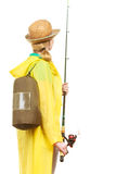 Woman with fishing rod, spinning equipment. Fishery, spinning equipment, angling sport, activity concept. Woman wearing raincoat and backpack holding fishing rod royalty free stock photo